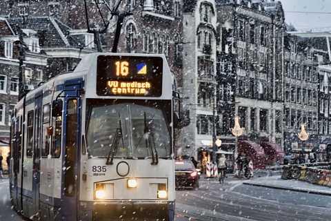 Snowy amsterdam afternoon by Scott Joyce