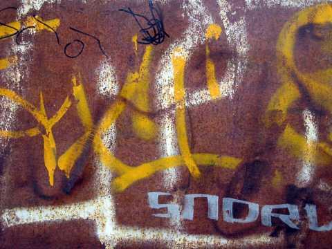 Yellow on rust by Scott Joyce