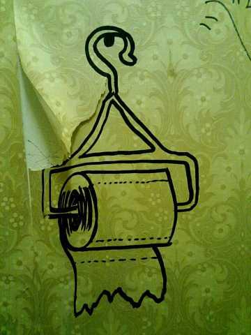 toilet roll in toilet by Scott Joyce