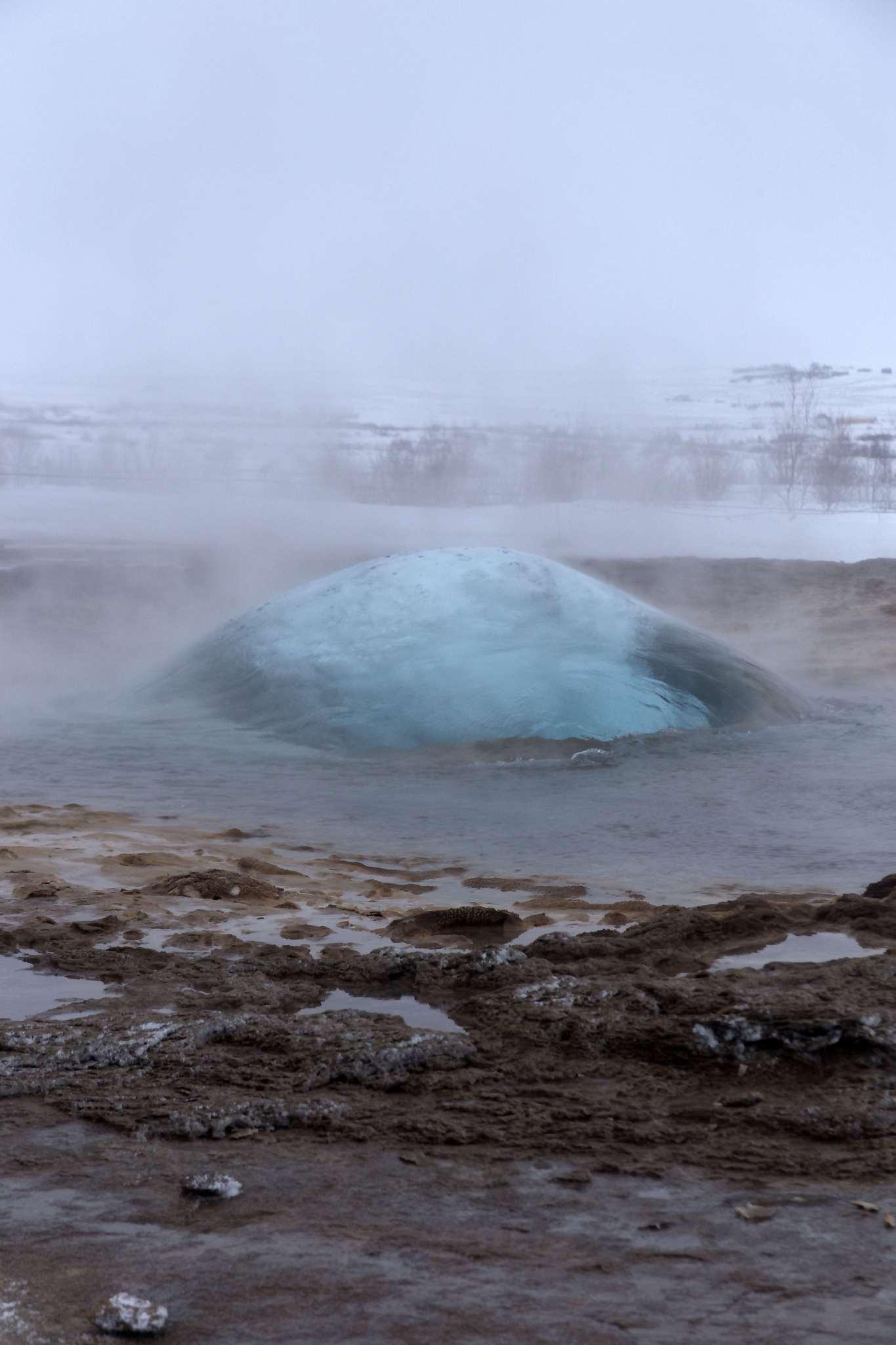 A geyser at Geysìr about to blow.