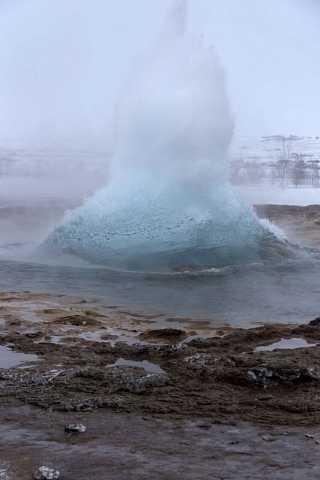 A geyser at Geysìr starts to blow by Scott Joyce