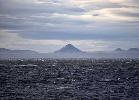 Volcano in the distance by Scott Joyce