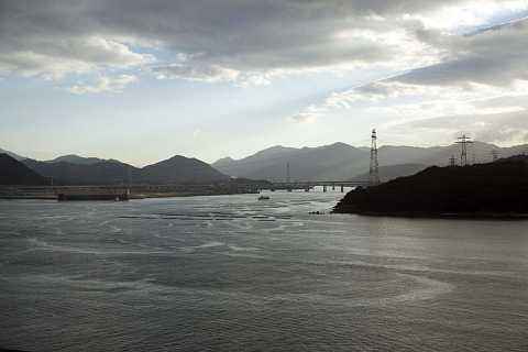 Hiroshima Port at low tide. by Scott Joyce