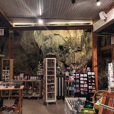 Gift shop that includes a giant rock wall... by Scott Joyce