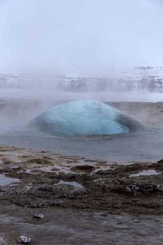 A geyser at Geysìr about to blow. by Scott Joyce