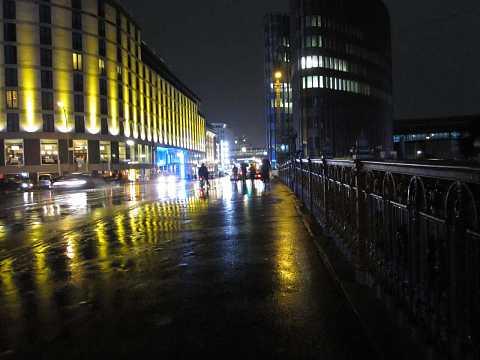 Friedrichstraße by night by Scott Joyce